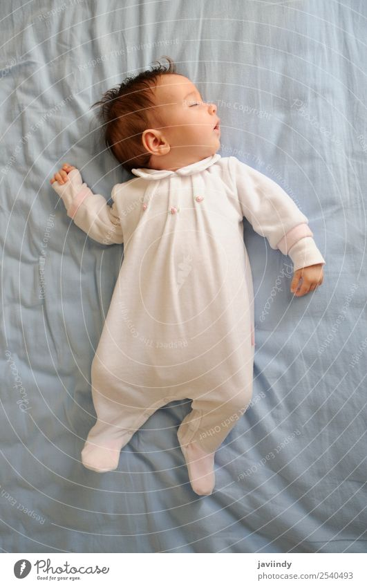 Newborn baby girl sleeping on blue sheets at home Happy Beautiful Face Life Child Human being Baby Girl Boy (child) Woman Adults Parents Infancy 1 0 - 12 months