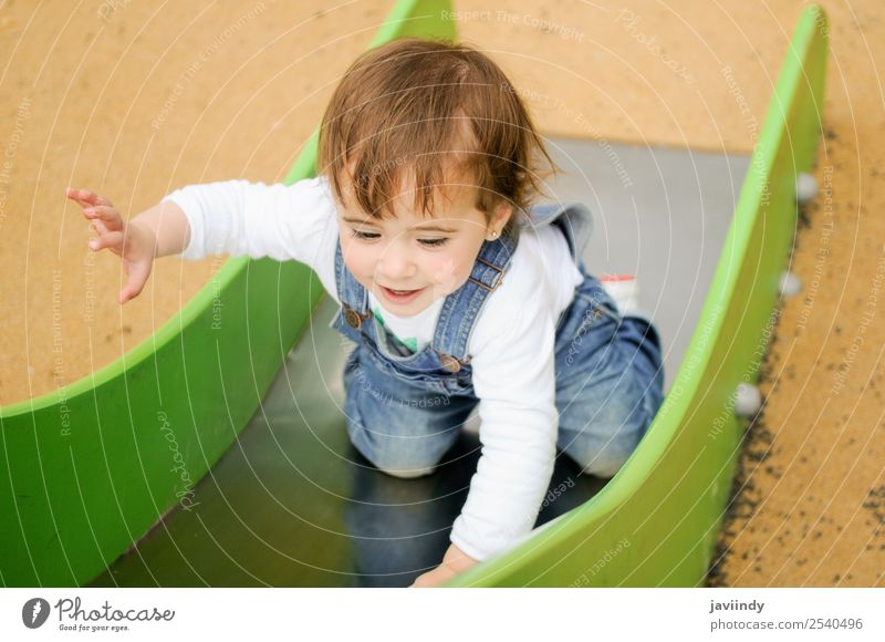 Baby girl playing in urban playground Lifestyle Joy Happy Beautiful Leisure and hobbies Playing Summer Climbing Mountaineering Child Human being Feminine