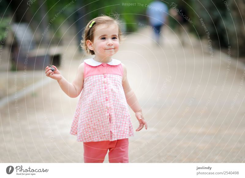 Little girl playing in a urban park Lifestyle Joy Happy Beautiful Leisure and hobbies Playing Summer Child Human being Girl Woman Adults Infancy 1 1 - 3 years
