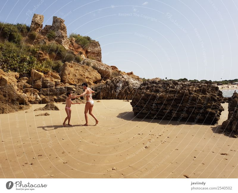 Mother and little daughter having fun on the beach of the Wall of Puerto Sherry Lifestyle Joy Happy Beautiful Playing Vacation & Travel Summer Sun Beach Ocean