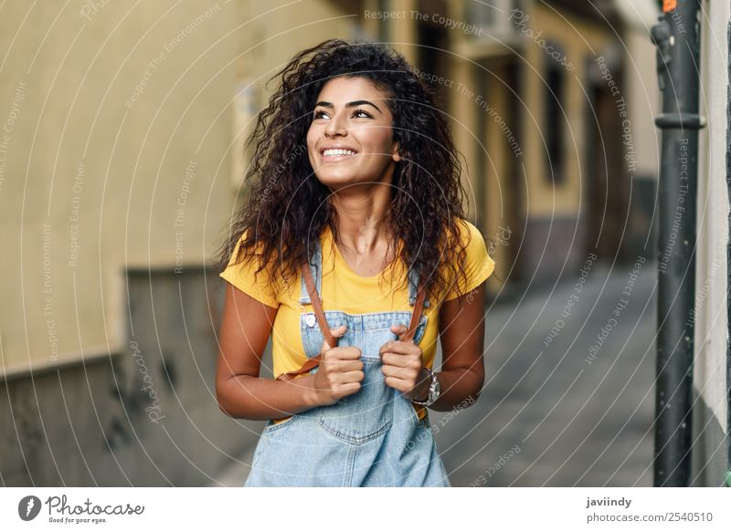 Young Arab tourist woman with black curly hairstyle Lifestyle Style Happy Beautiful Hair and hairstyles Face Tourism Human being Feminine Young woman