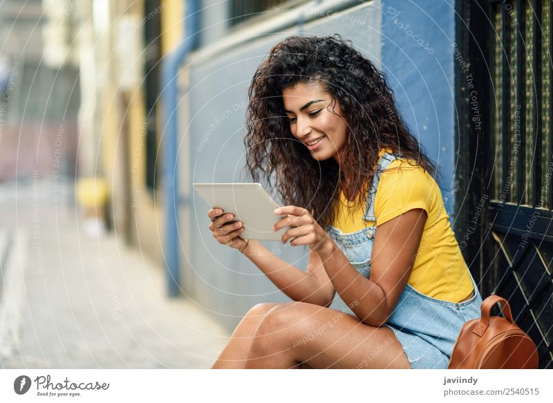 Young Arab woman looking at her digital tablet Lifestyle Style Happy Beautiful Hair and hairstyles Tourism Technology Human being Feminine Young woman