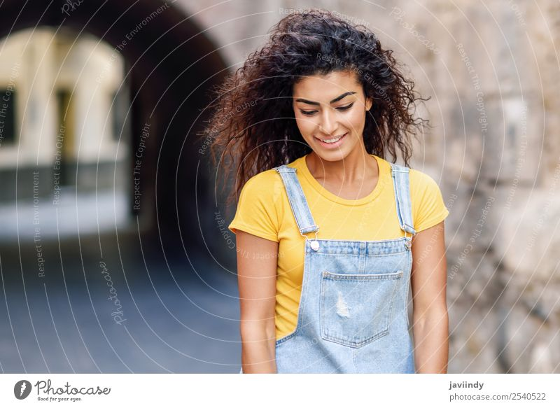 Young Arab woman with curly hairstyle outdoors Woman Human being Youth (Young adults) Young woman Beautiful 18 - 30 years Black Face Street Lifestyle Adults