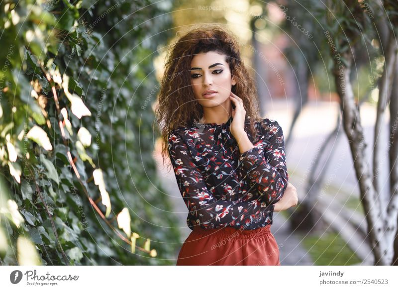 Beautiful young Arab woman with black curly hairstyle Lifestyle Style Hair and hairstyles Human being Feminine Young woman Youth (Young adults) Woman Adults 1