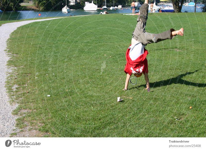 Child Man Summer Joy Sports Meadow Playing Lake Gymnastics Light heartedness Handstand Cartwheel