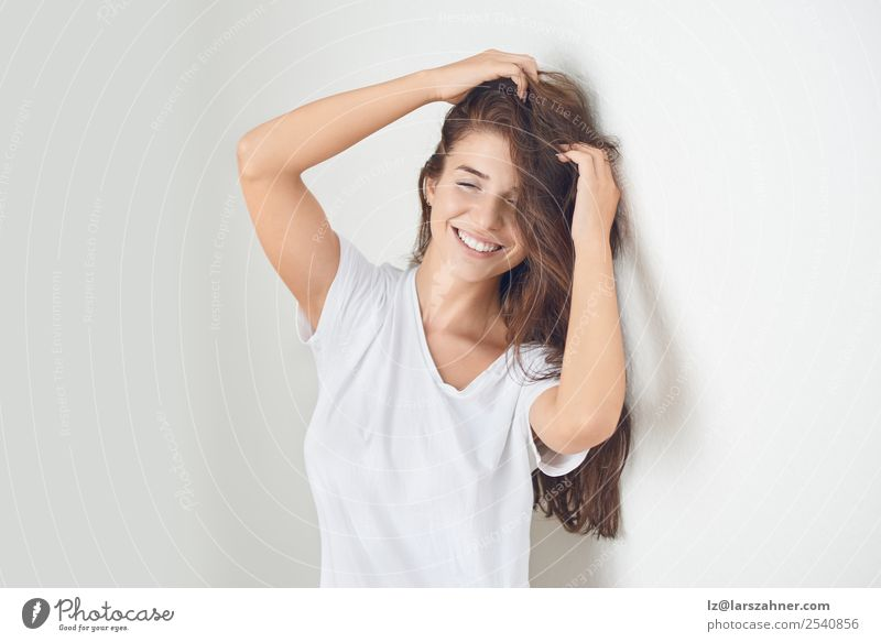 Young smiling blond woman leaning against wall Woman Human being Youth (Young adults) Beautiful White 18 - 30 years Face Lifestyle Adults Natural Happy