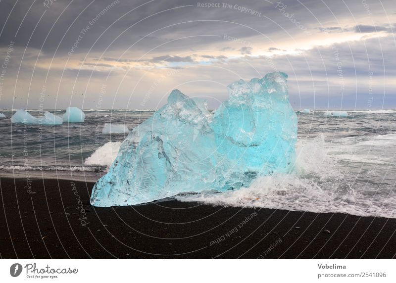 Ice at Joekulsarlon, Iceland Relaxation Meditation Vacation & Travel Adventure Ocean Waves Nature Landscape Elements Water Clouds Gale Glacier Lake Cold Iceberg