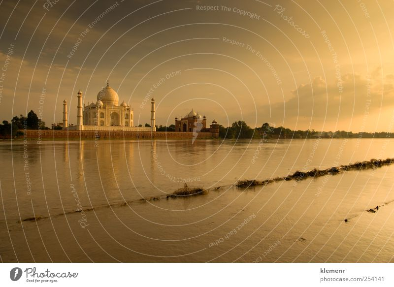 Taj Mahal in sunset scene Environment Water Clouds River bank Places Architecture Mosque Palace Vacation & Travel Esthetic Authentic Exceptional Gigantic Bright