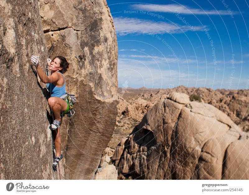 Female rock climber clinging to a cliff. Human being Youth (Young adults) Adults Sports Power Adventure Rope Success 18 - 30 years Young woman Climbing Trust Peak Fitness Risk Brave