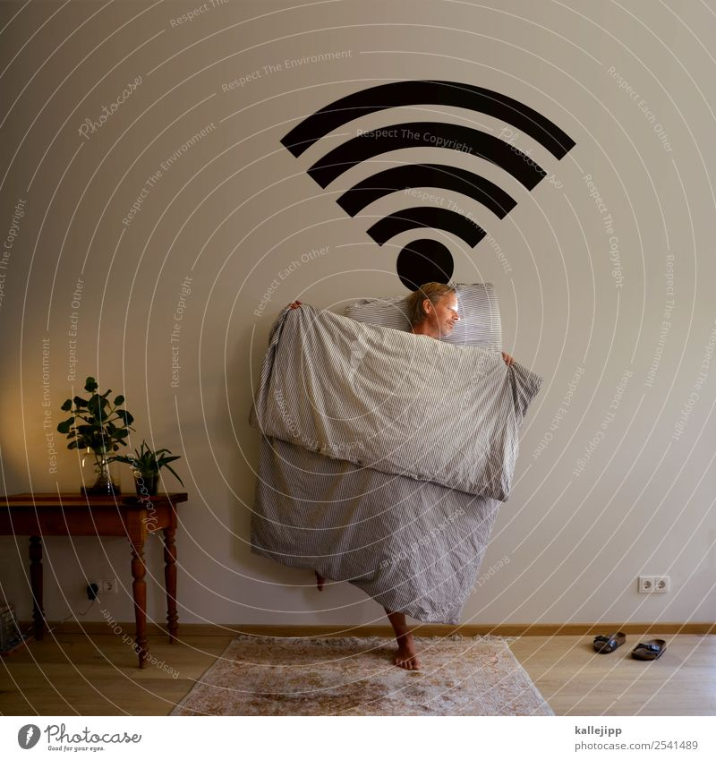 Man sleeps W-Lan Lifestyle Living or residing Flat (apartment) Interior design Furniture Lamp Table Bedroom Telephone mobile Computer Notebook Technology
