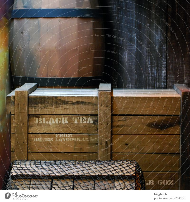 black tea Tea Trade Logistics Crate Keg Wood Old Brown Colour photo Subdued colour Interior shot Deserted Artificial light Tea chest Black tea Wooden box