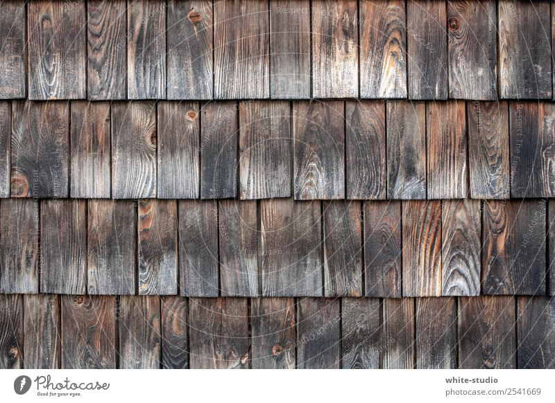 Wood in front of the hut House (Residential Structure) Safety (feeling of) Roofing tile Shingle Architecture Hut Chalet vacation Tradition Wall cladding