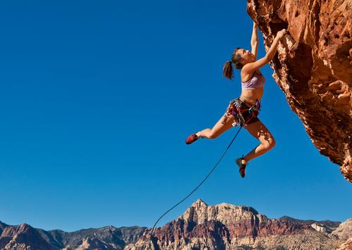 Rock climber on the edge. Life Adventure Sports Climbing Mountaineering Success Rope Young woman Youth (Young adults) 1 Human being 18 - 30 years Adults Hang
