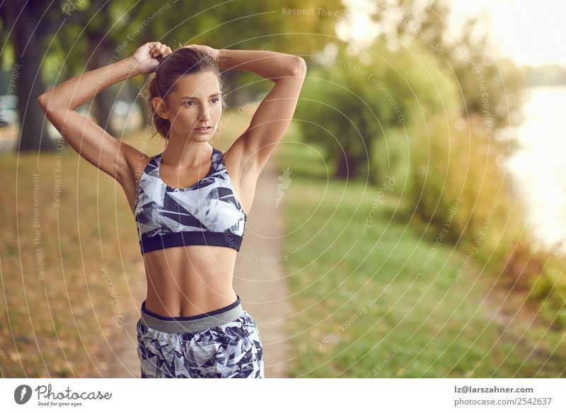 Slender fit shapely woman in sportswear Lifestyle Happy Summer Sports Jogging Woman Adults 1 Human being 18 - 30 years Youth (Young adults) Warmth Park Lake