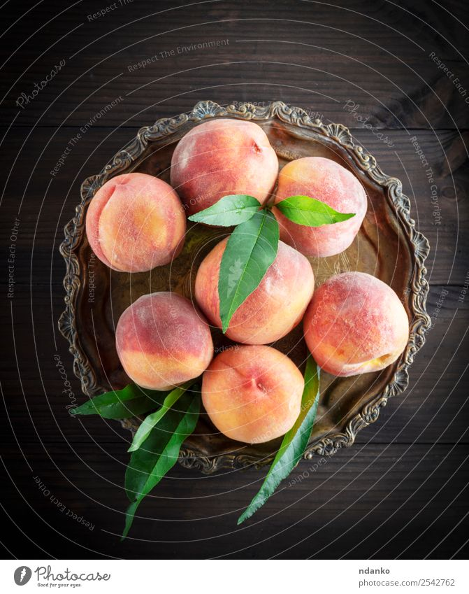 fresh ripe peaches Fruit Dessert Nutrition Vegetarian diet Bowl Gardening Leaf Wood Fresh Natural Juicy Yellow Green Red Peach Raw Mature sweet background