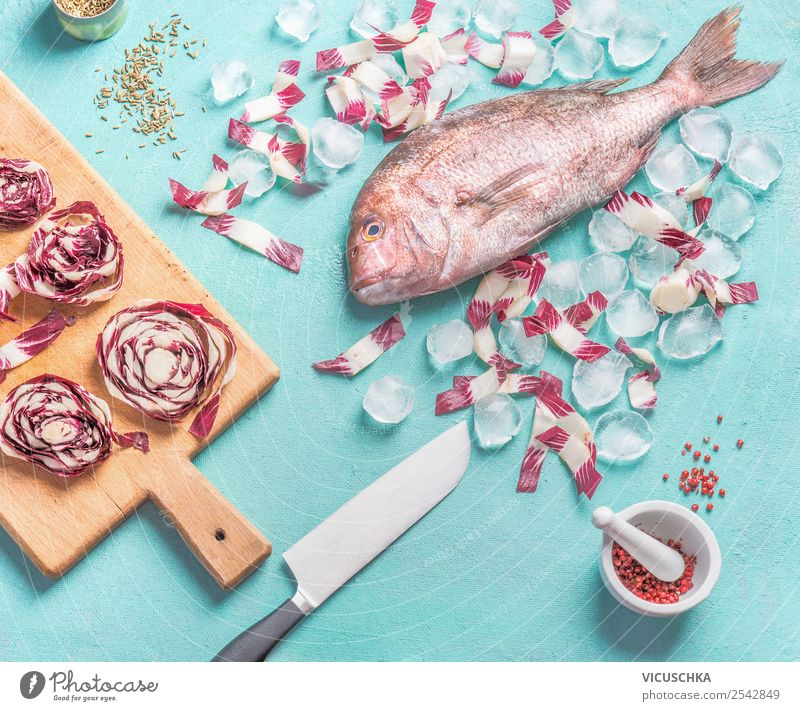 Rosa Dorado fish with knife and ingredients Food Fish Vegetable Herbs and spices Nutrition Organic produce Vegetarian diet Diet Knives Style Design