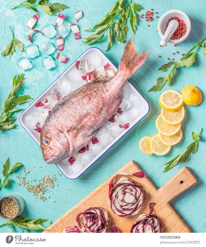 Dorado fish on kitchen table with ingredients Food Fish Herbs and spices Cooking oil Nutrition Lunch Dinner Organic produce Vegetarian diet Diet Crockery Style