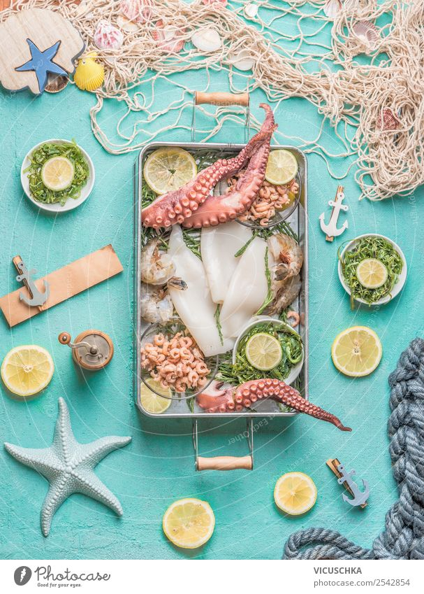 seafood on a blue kitchen table Food Seafood Nutrition Crockery Shopping Style Design Healthy Eating Restaurant Octopus Squid Cooking Food photograph Algae