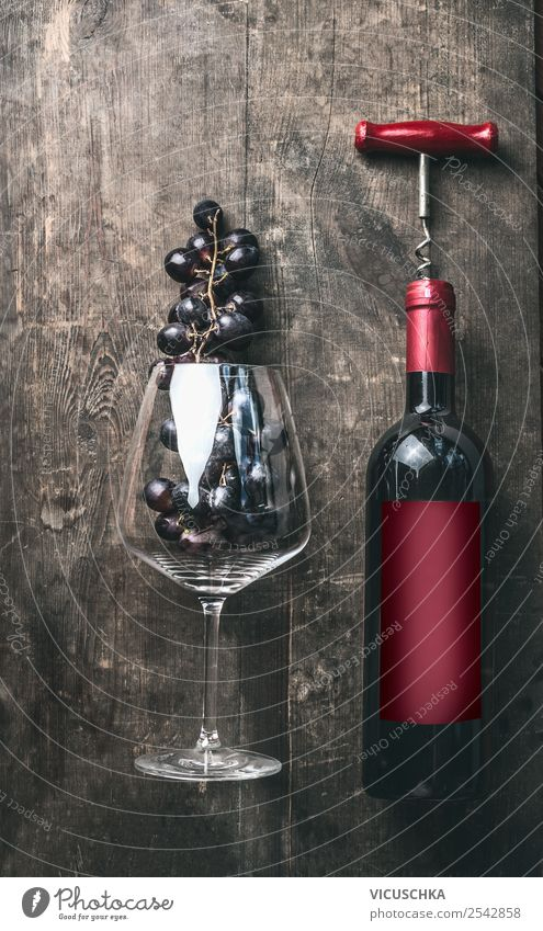 Red wine bottle and red wine glass with grapes Fruit Nutrition Dinner Banquet Beverage Alcoholic drinks Wine Bottle Glass Shopping Elegant Style Table