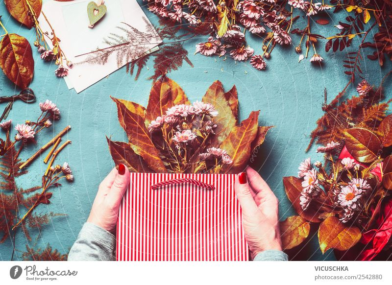 Hands hold paper bag with autumn flowers and leaves Shopping Style Table Feasts & Celebrations Autumn Flower Leaf Blossom Decoration Bouquet Hip & trendy Yellow