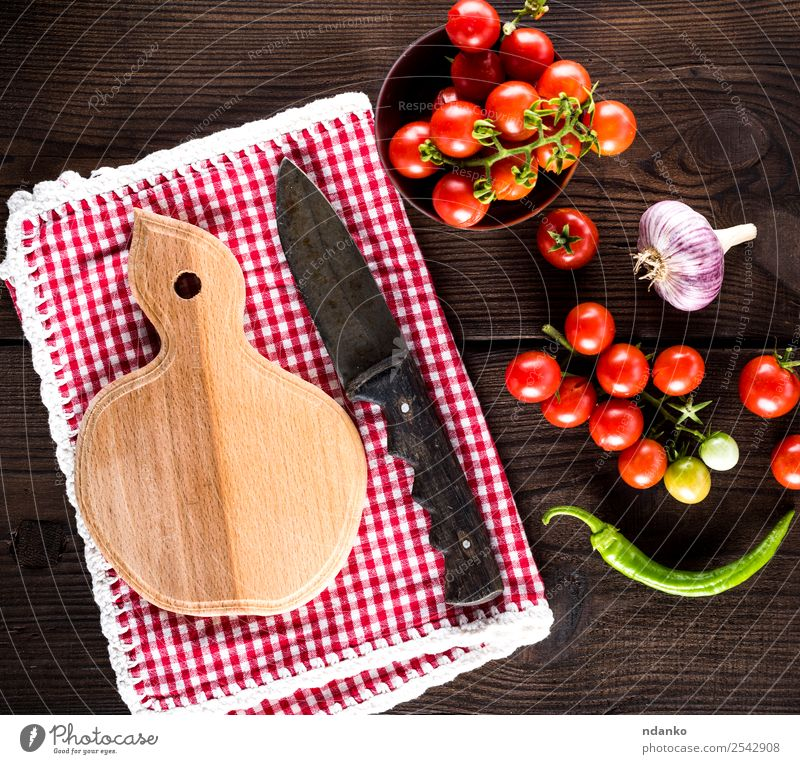 ripe red cherry tomatoes Red Eating Yellow Wood Brown Above Fresh Herbs and spices Vegetable Tradition Cooking Mature Knives Tomato Chopping board Cherry