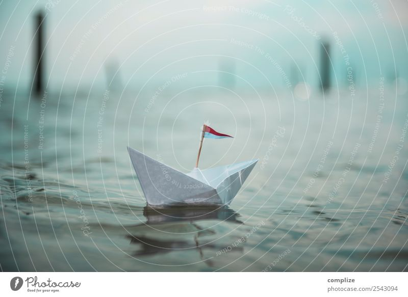 A paper ship with a flag on the sea Wellness Relaxation Vacation & Travel Summer Summer vacation Beach Ocean Island Waves Sailing Coast Lakeside River bank Bay
