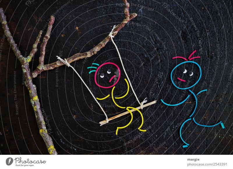 Rubber worms: A child sits on a swing that is tied to a tree. He gets pushed and is afraid Leisure and hobbies Playing Human being Masculine Feminine