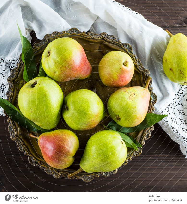 ripe green pears Fruit Nutrition Vegetarian diet Diet Plate Table Nature Leaf Wood Eating Fresh Natural Juicy Yellow Green Pear background Rustic food healthy