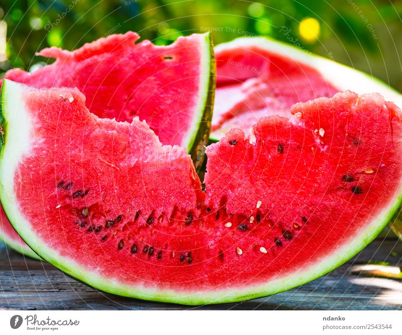slice of ripe red watermelon Fruit Candy Nutrition Vegetarian diet Summer Table Nature Wood Fresh Delicious Natural Juicy Green Red Colour Water melon Organic