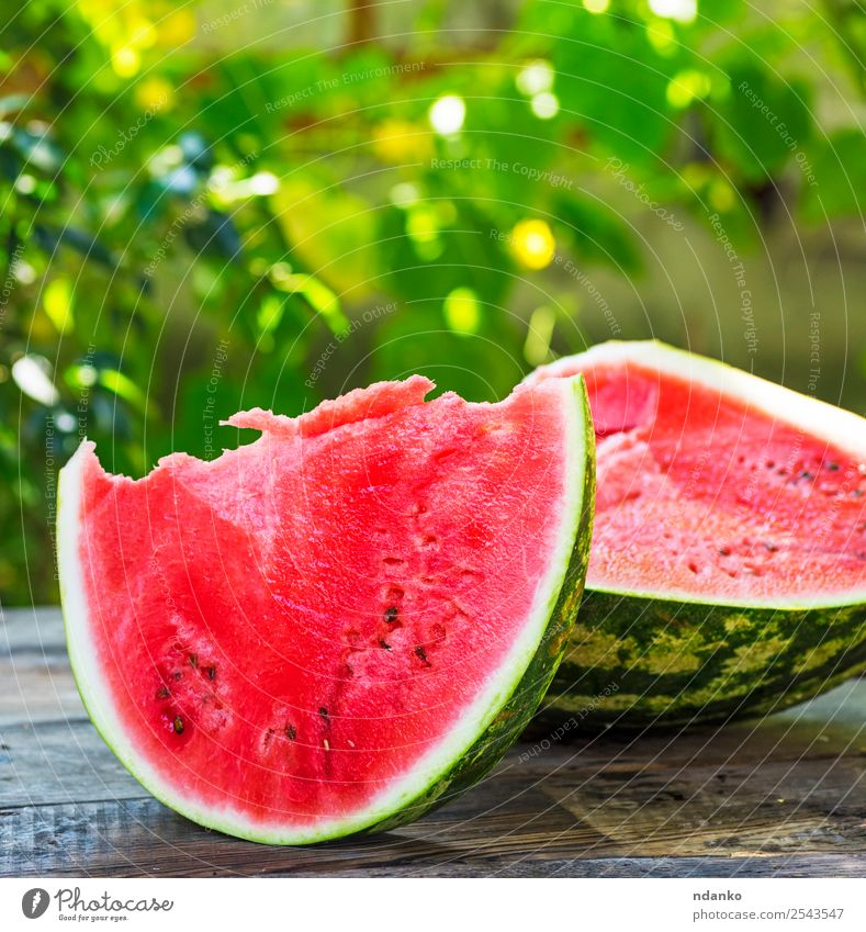 cut a ripe watermelon Fruit Nutrition Vegetarian diet Table Nature Wood Eating Fresh Natural Juicy Green Red Colour Water melon background Slice food sweet