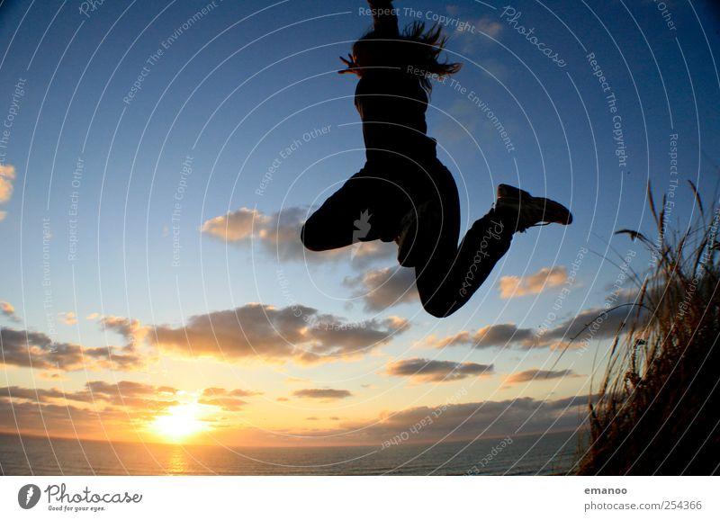 Human being Sky Vacation & Travel Sun Summer Ocean Beach Joy Landscape Emotions Freedom Jump Coast Style Weather Waves