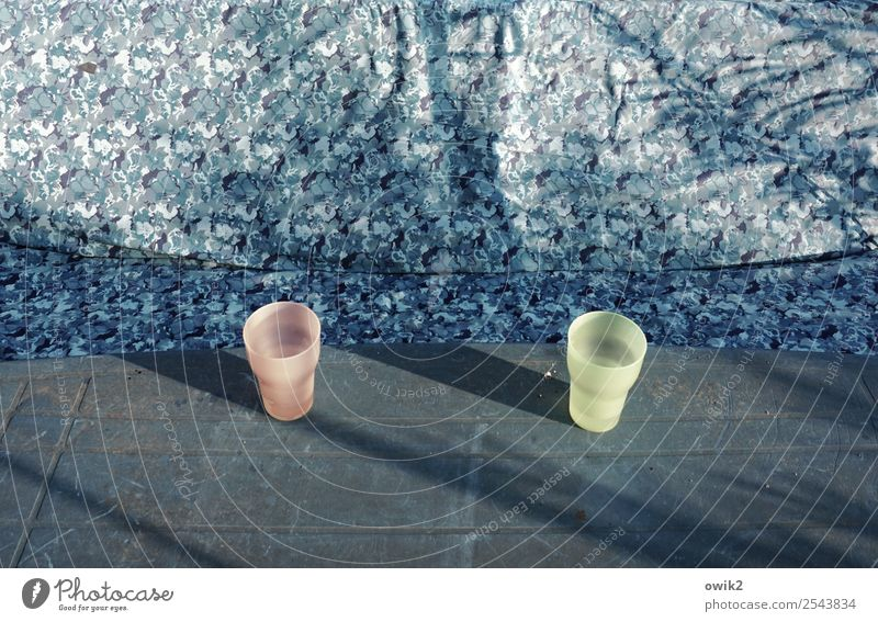 juxtaposition Garden table Swing Mug 2 In pairs Plastic Stand Wait Opposite Empty Gap Bluish Slate blue Gray-blue Pink Bright yellow Colour photo Subdued colour