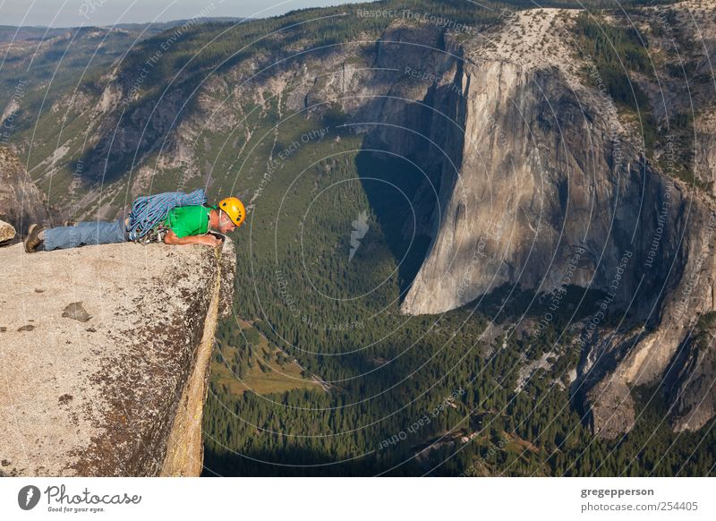 Rock climber on the summit. Human being Man Life Sports Adults Contentment Masculine Adventure Rope Success Climbing Trust Peak Brave Joie de vivre (Vitality)