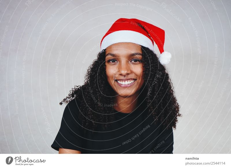 Young woman with a santa's hat Style Design Joy Feasts & Celebrations Christmas & Advent New Year's Eve Human being Feminine Youth (Young adults) Woman Adults 1