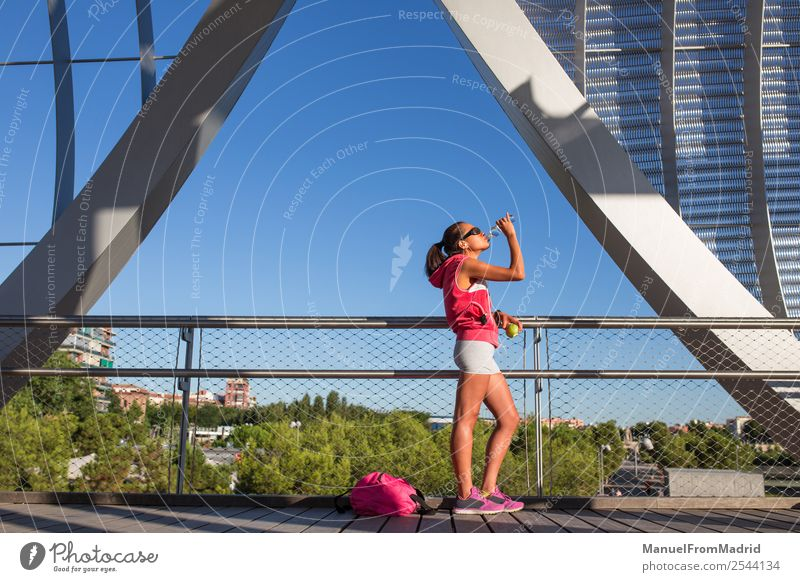 young woman runner having a rest outdoors Drinking Lifestyle Happy Beautiful Body Wellness Summer Sports Jogging Human being Woman Adults Fitness Runner running