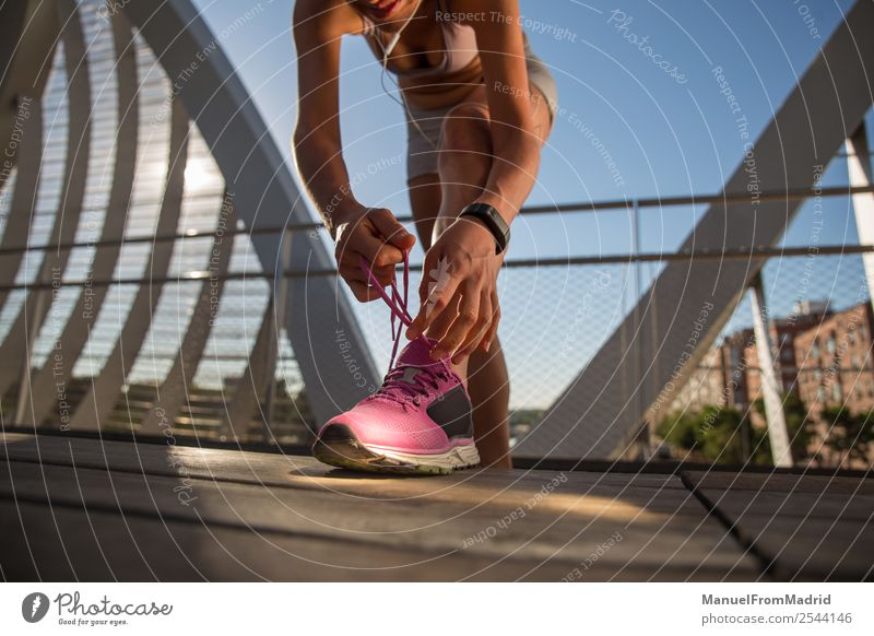 woman runner tying shoe laces Lifestyle Happy Beautiful Body Wellness Summer Sports Jogging Human being Woman Adults Footwear Fitness Runner running Shoelace