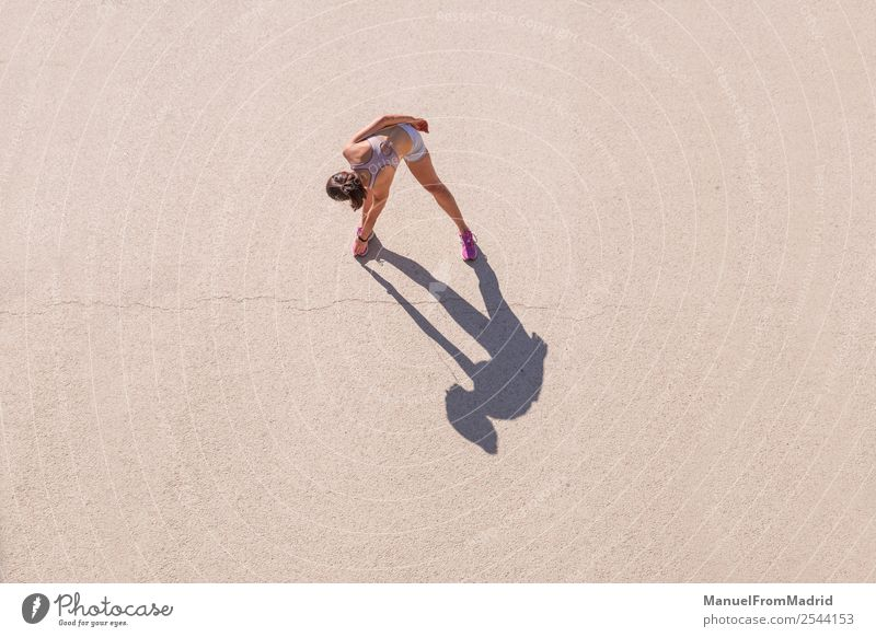 Overhead view of a woman runner stretching Lifestyle Happy Beautiful Body Wellness Summer Sports Jogging Human being Woman Adults Fitness Runner overhead