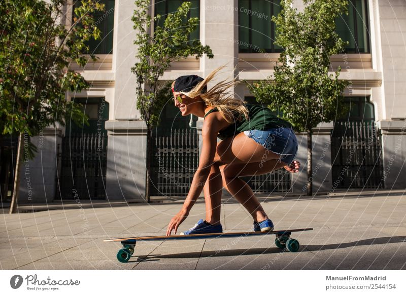 young woman skating Lifestyle Style Joy Happy Beautiful Summer Woman Adults Street Fashion Sunglasses Blonde Smiling Cool (slang) Hip & trendy casual riding