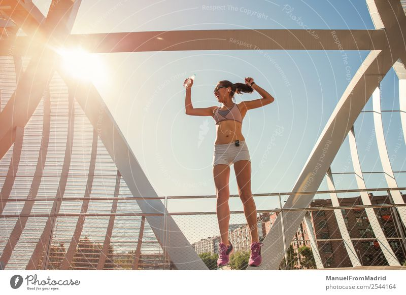 female runner jumping for joy Lifestyle Happy Beautiful Body Wellness Summer Sports Success Jogging Human being Woman Adults Fitness Jump Runner achievement