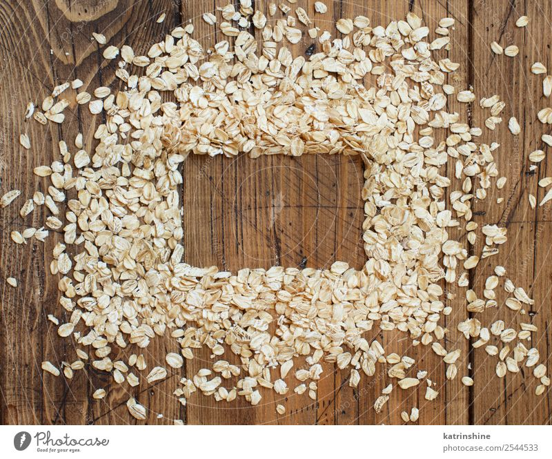 Rolled oats top view Nutrition Breakfast Vegetarian diet Diet Summer Nature Wood Natural background Cereal Cooking flakes food grain health healthy Ingredients