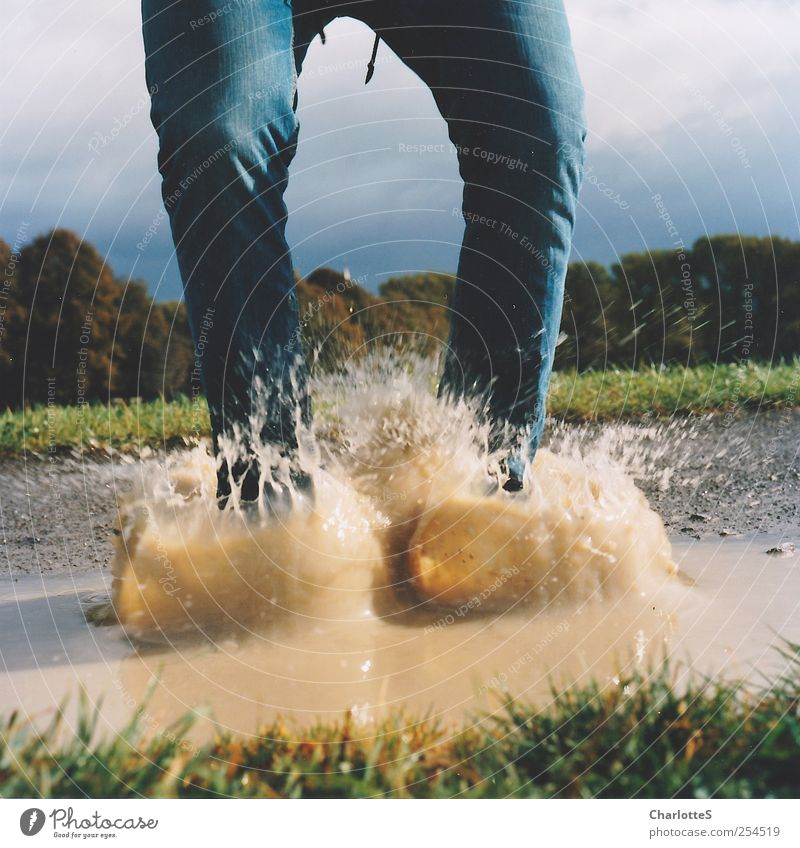 Human being Nature Water Joy Meadow Grass Jump Lanes & trails Legs Rain Feet Brown Field Dirty Walking Swimming & Bathing