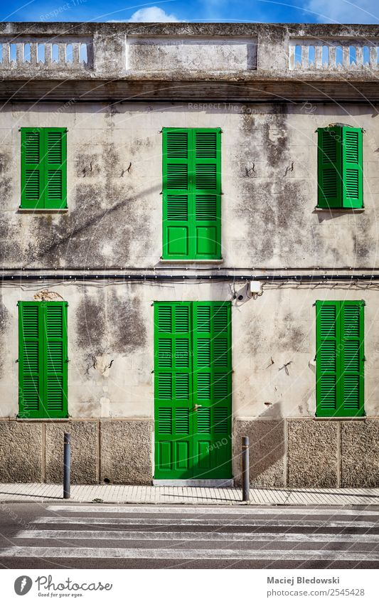 Old building facade with green door and shutters. Living or residing House (Residential Structure) Dream house House building Village Small Town Building