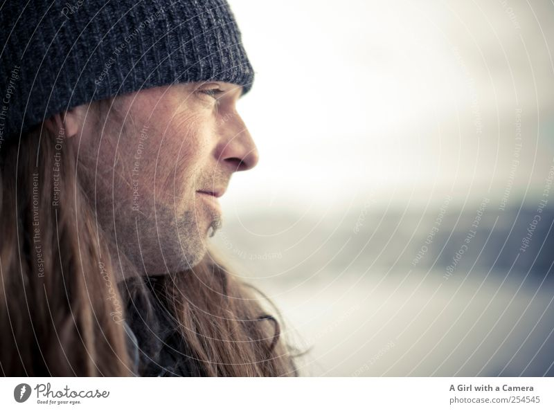 love him Human being Masculine Man Adults Life Head 1 30 - 45 years Cap Long-haired Designer stubble Looking Dream Dreamily Sadness Winter Exterior shot