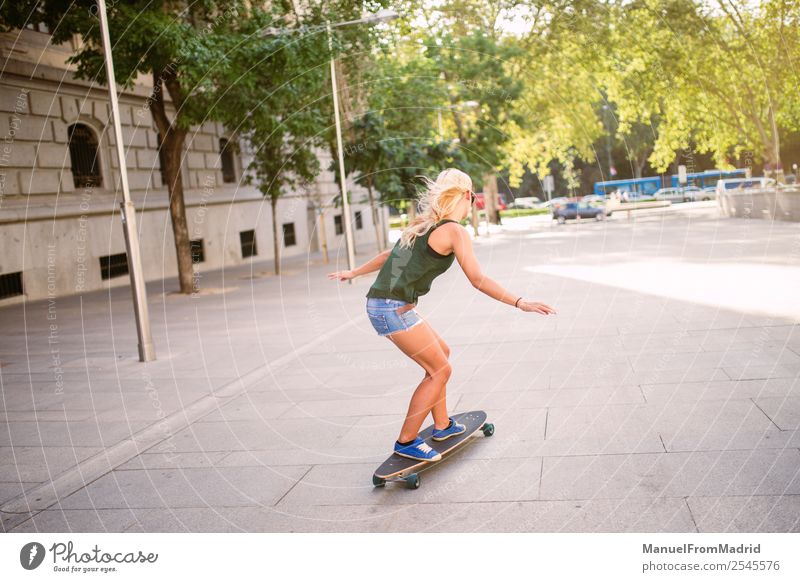 young woman skating Lifestyle Style Joy Beautiful Leisure and hobbies Summer Woman Adults Downtown Street Blonde Cool (slang) Eroticism Hip & trendy casual