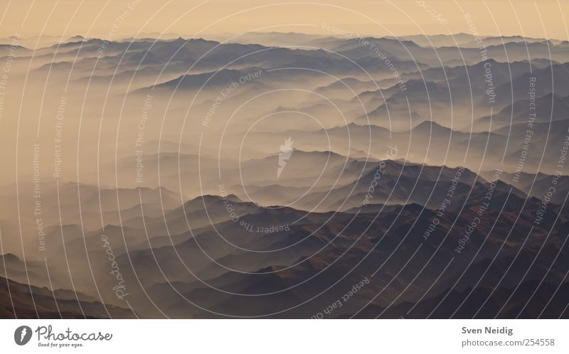the Sea of Fog I Nature Earth Clouds Alps Mountain Peak Infinity Blue Yellow Sublime Colour photo Aerial photograph Structures and shapes Deserted Dawn Sunrise