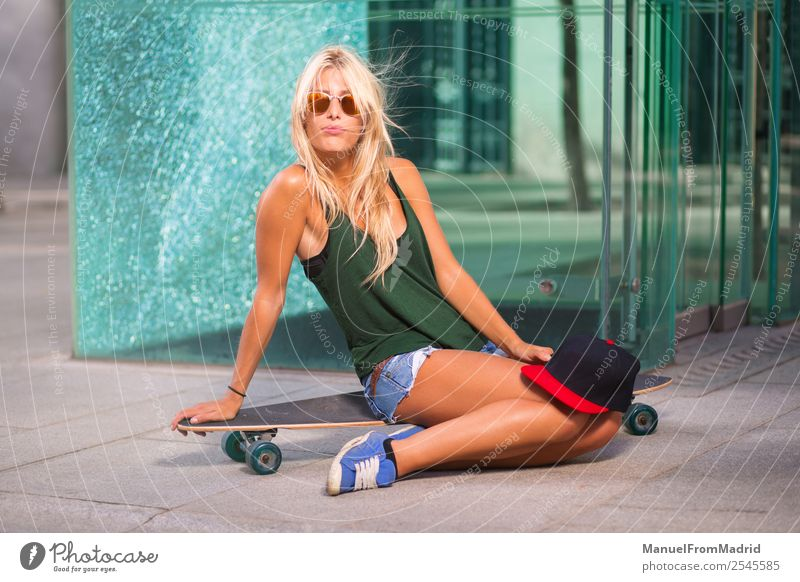 young woman skater posing Lifestyle Style Joy Beautiful Summer Woman Adults Downtown Street Sunglasses Blonde Cool (slang) Eroticism Hip & trendy casual