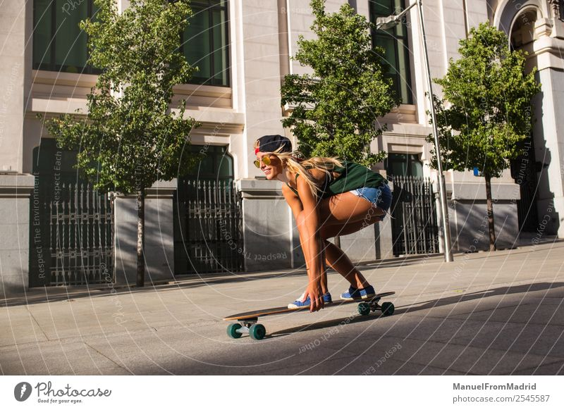 young woman skating in the street Lifestyle Style Joy Beautiful Leisure and hobbies Summer Woman Adults Downtown Street Sunglasses Blonde Movement Smiling