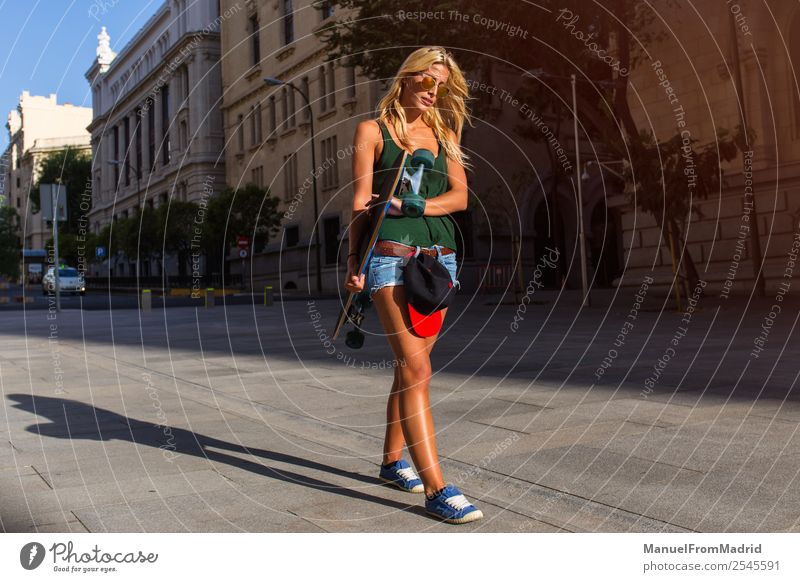 young woman skating in the street Lifestyle Style Joy Beautiful Summer Woman Adults Downtown Street Sunglasses Blonde Cool (slang) Eroticism Hip & trendy casual