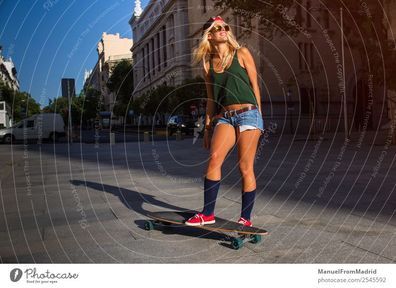 young woman skating in the street Lifestyle Style Joy Beautiful Leisure and hobbies Summer Woman Adults Downtown Street Sunglasses Blonde Smiling Cool (slang)