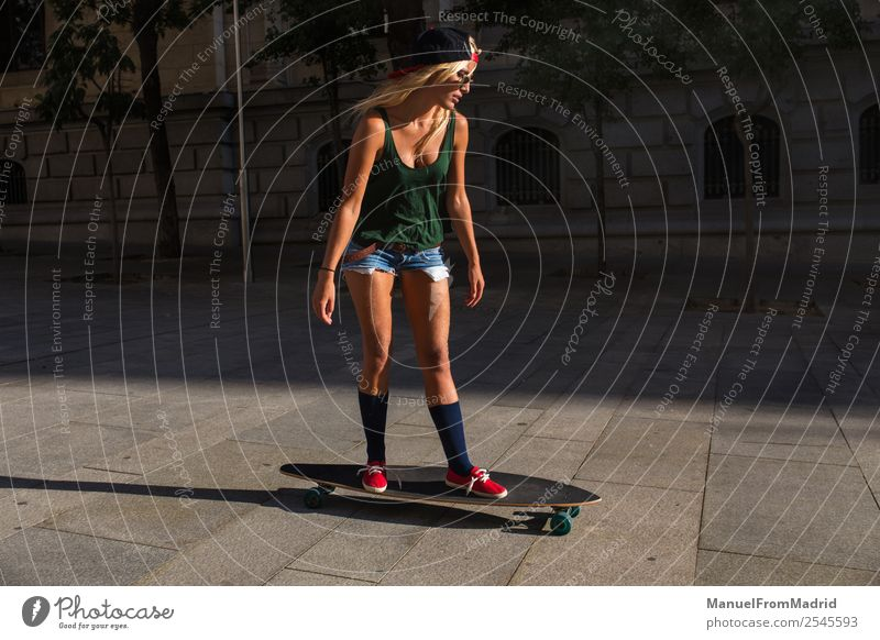 young woman skating in the street Lifestyle Style Joy Beautiful Leisure and hobbies Summer Woman Adults Downtown Street Sunglasses Blonde Cool (slang) Eroticism